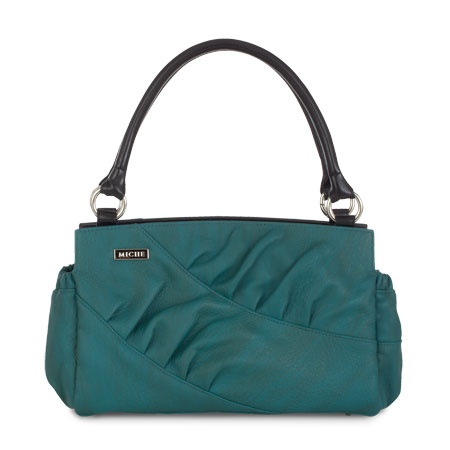 Autumn    The first thing to hit you is the color. Autumn for Classic Bags boasts a striking shade of teal that makes your heart beat a little faster whenever you put her on. Autumn is stunning, yet understated—letting your inner strength come shining through. Subtle texturing and smart touches like pleating details along diagonal stitching lines create an unforgettable look that is sure to become your new favorite. End pockets.: Autumn Classic, Classic Shells, Fashion Style, Classic Me, Me Classic, Me Bags, Classic Autumn, Heart Beats, Classic Bags