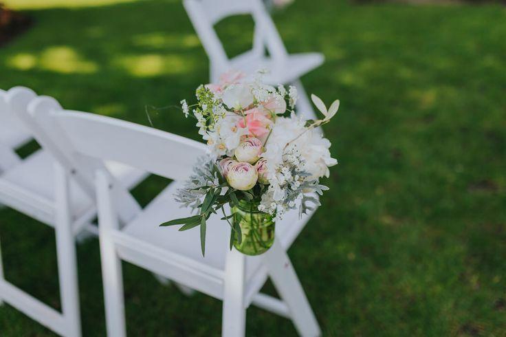 Beautiful aisle flower arrangements by @whfco. Photo by Benjamin Stuart Photography #weddingphotography #whitehorseflowercompany #weddingflowers #ceremonyflowers #aisleflowers #weddingideas