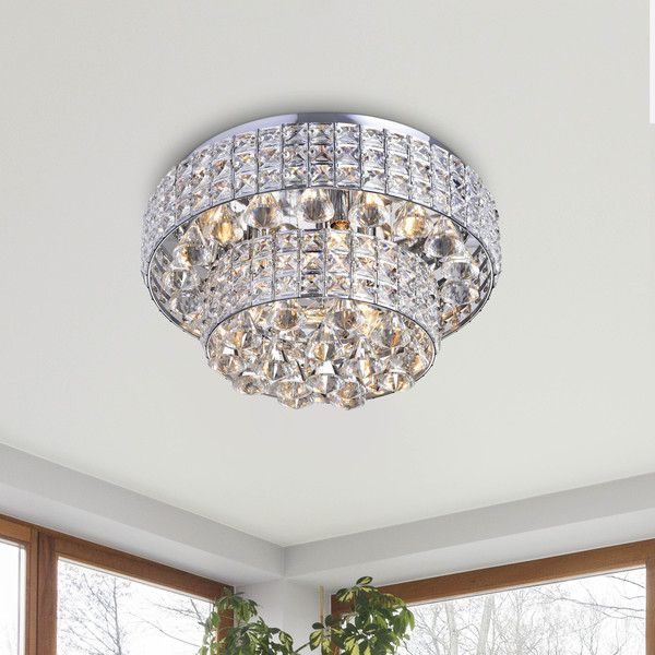 Light up your home with this Jolie Chrome Two Tier Crystal Shades Flush Mount Chandelier. This 6 -light chandelier is made of iron and crystal and features a chrome finish that will enhance the decor