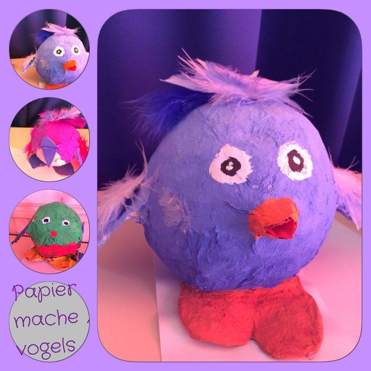 Papier mache - vogels - groep 8 - ballon met papier mache (vleugels en poten met karton), verven, veertjes, misschien plakoogjes?,