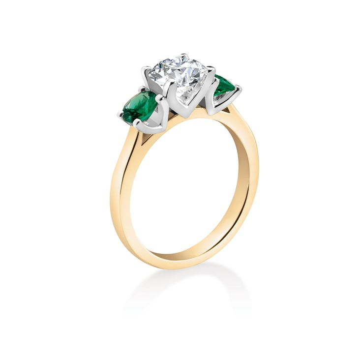 Magnificent Colombian emeralds in a superb platinum setting offset a sparkling white diamond with yellow gold band.  Starting From $1299