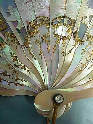 exquisite designs of elegant fans - should have bought that box of them -