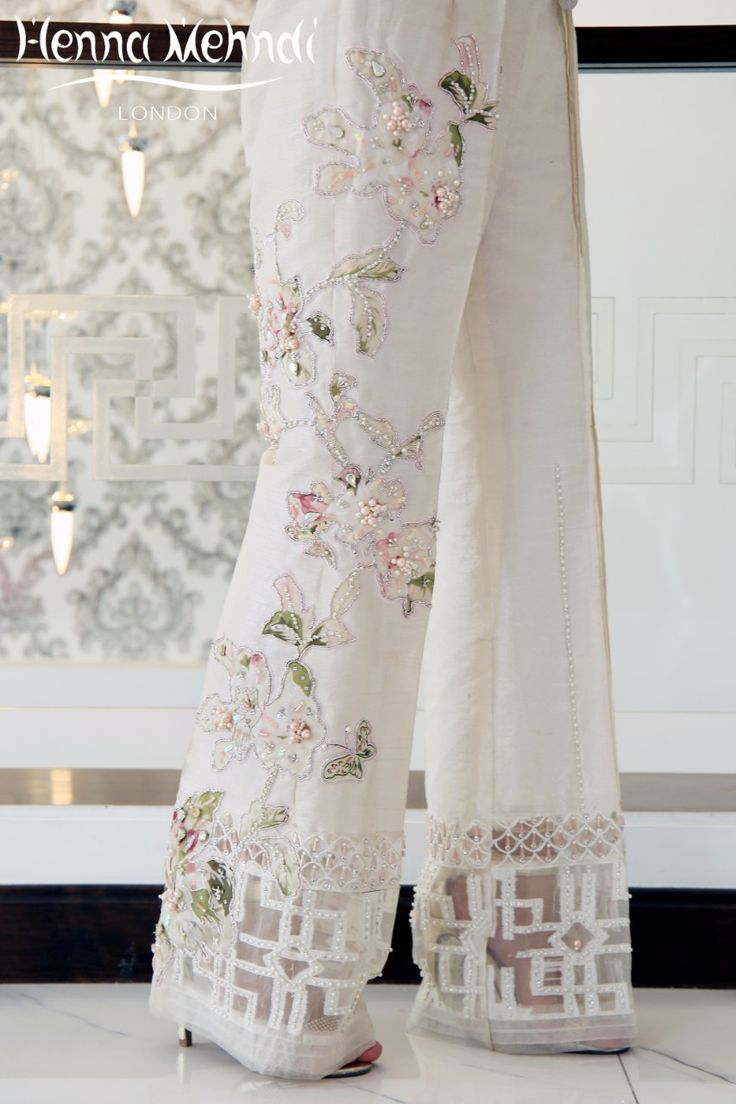 Ivory raw silk boot cut trousers with pink crystal embroidery and embellishment.  Please note these are trousers only. Please note delivery time is approximatel