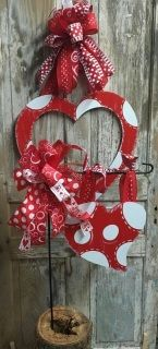 This Beautiful Heart Door Hanger Set includes Door hanger with bow and the matching flag pole heart with Side bow.  Does Not include flag Stand!