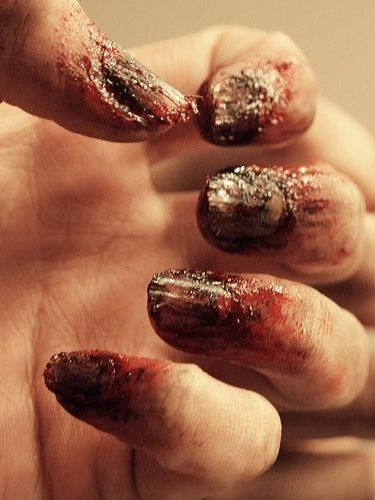 For a less subtle look: crusty zombie nails. | 27 Disgustingly Awesome Ways To Take Halloween To The Next Level