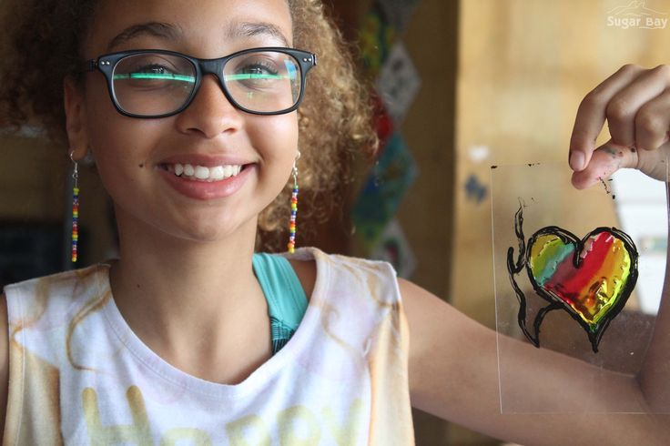 """Luana Loureiro of Maputo International College created this beautiful """"Heart on Fire"""" sun catcher. She loves Arts & Crafts classes at Sugar Bay & hasn't missed a single one since she got here. Visit the link below & learn how to create your own beautiful sun catchers in 3 simple steps."""