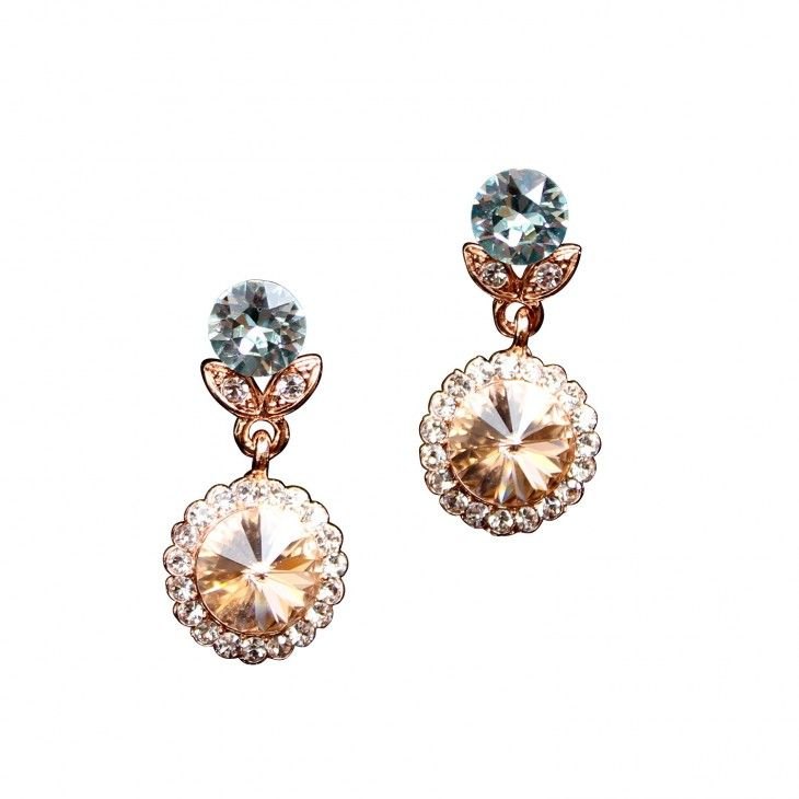 Earrings with light crystals Jessie Light peach earrings by Lily and Rose.   Information      Earrings with white, peach and light blue crystals in various sizes.    Length: 31 mm   Width: 16 mm    Crystals:   1.4 mm Crystal (Oktant, Austria)   1.5 mm Crystal (Oktant, Austria)    8.2 mm Light Azore (Swarovski, Austria)   10.6 mm Light Peach (Swarovski, Austria)