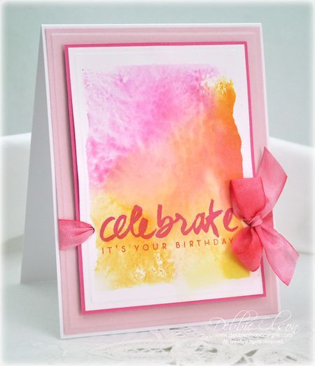 Distress inks on an acrylic block and spirited with water.
