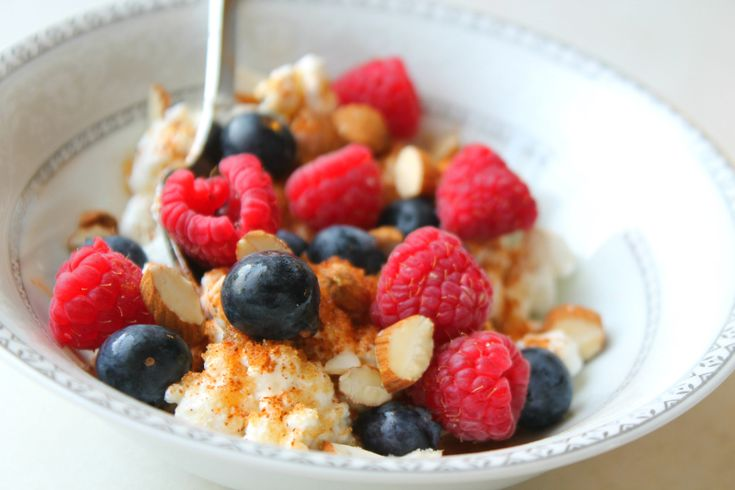 Cottage cheese topped with yummy berries and almonds.