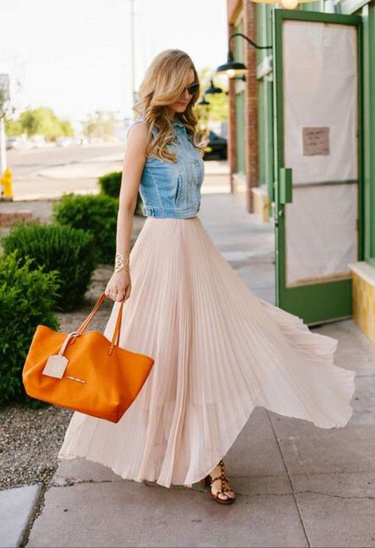 Whirlwind: A Little Dash of Darling blogger is wearing an Alice & Olivia pleated skirt, Old Navy denim vest, Valentio rockstud heels, Elaine Turner orange tote and Ray-Ban sunglasses.