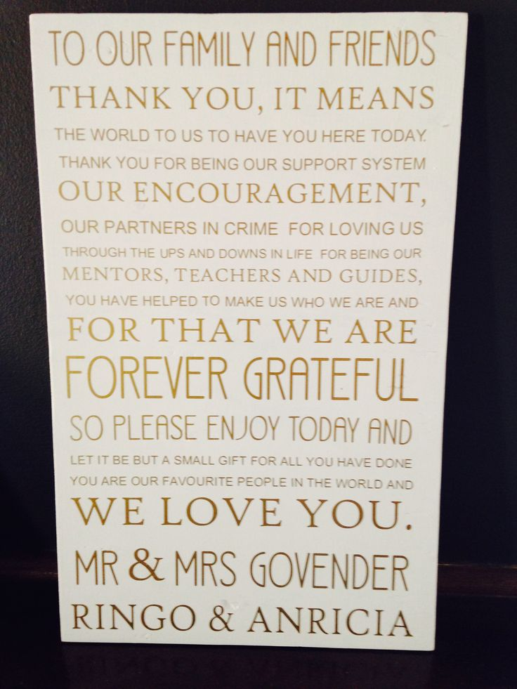 Wooden wall art with personalised message for wedding guests