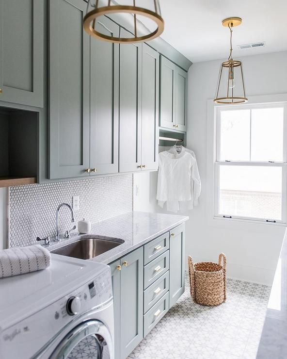 Laundry Room: Light Blue Cabinets, Brass Hardware, Cement