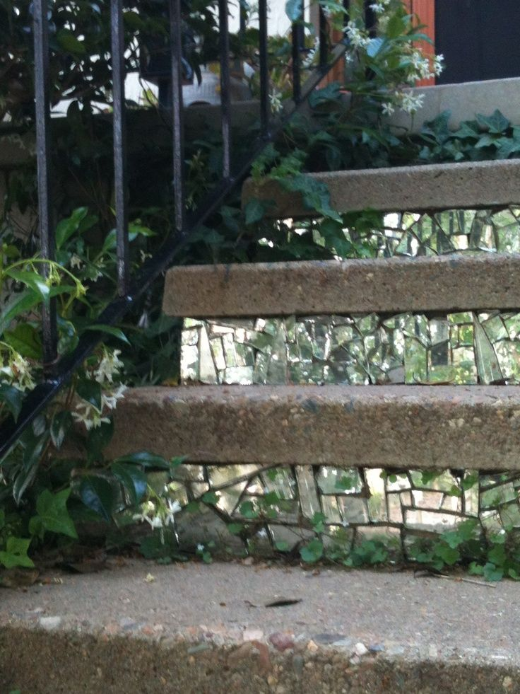 Use broken mirror mosaic on stair risers outdoors or in to bring intrest to boring stairs