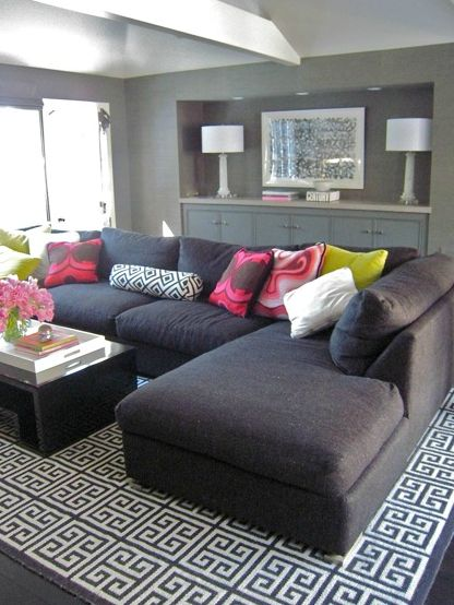 David Hicks La Florentina Jonathan Adler Greek Key Rug charcoal gray sectional sofa chaise lounge charcoal gray walls glossy black modern coffee table gray cabinets david Hicks La Fiorentina bolster pillow hot pink pillows white lacquer tray