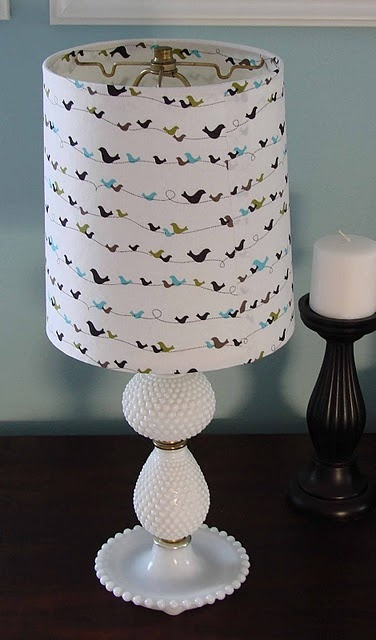 Milk glass lamp base with a recovered whimsical shade. I love the birds!