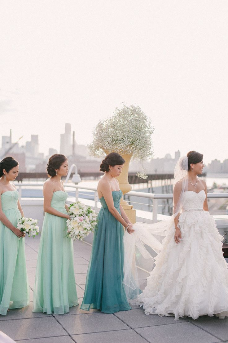 Maid of honor wears a different shade of the bridesmaid's dresses to stand out just a little. love this.