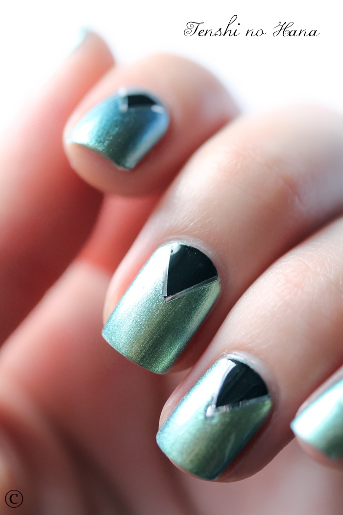 blue green nails with black triangle base