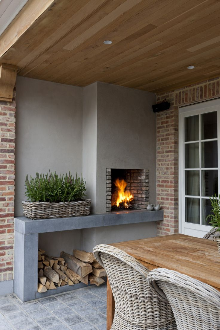 Like the concrete near the fire, great feature for inside. I can imagine a wood fire under it, the flue coming through it and then up, and leaving the space next to fie empty still to stack wood.