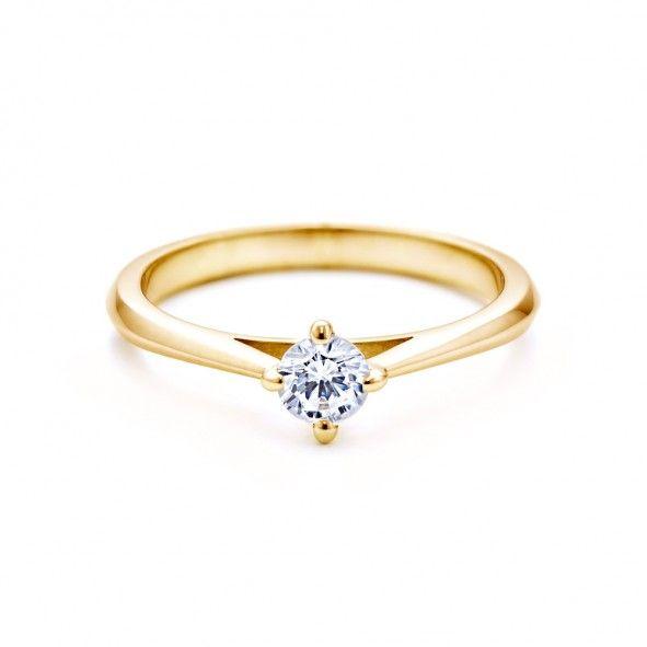 Pierścionek zaręczynowy z diamentem 0,20 ct o szlifie brylantowym wysokiej czystości SI1/G, wykonany z 18-karatowego żółtego złota (próba 0,750). www.savicki.pl/kolekcje/the-light-pl