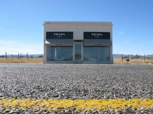 """Prada Marfa – Texas, United States: This workmanship establishment remains as a """"pop engineering area venture"""" in the remote town of Marfa, Texas. While its #facade guarantees extravagance products, the entryway can't be opened... Prada Marfa was debilitated a few years back after it was considered to be an ad, yet the state's Department of Transportation said it would rename it as a #museum."""