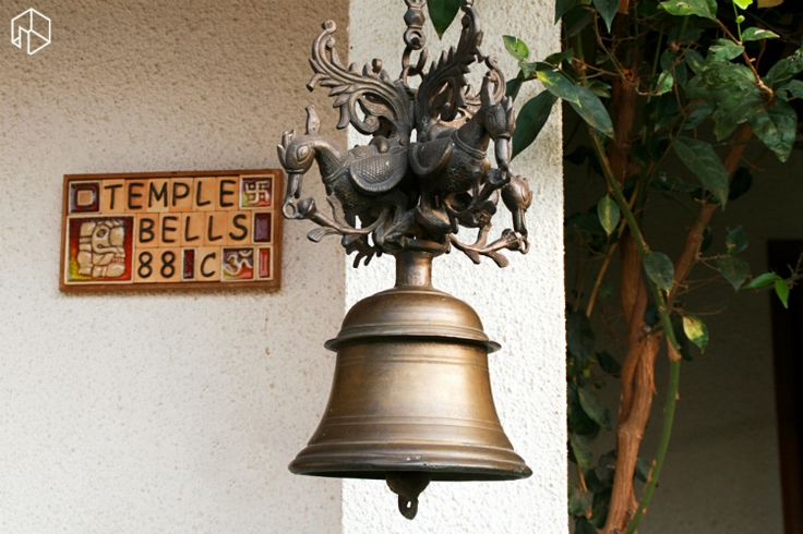 Traditional bell at the entrance of Arati and Sundaresh's home.