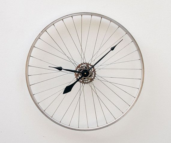 Recycled Bike Wheel Clock on Etsy, $127.00 I've got extra bike wheels around the house......