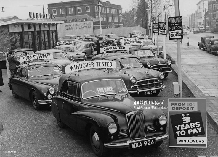 Cars for sale at the Windovers dealership in Hendon, north London, November 8 1958. A sign advertises cars for sale with a deposit from 10 percent and three years to pay. Car sales are increasing after the British government's lifting of restrictions on hire-purchase credit terms. (Photo by Paul Popper/Popperfoto/Getty Images)