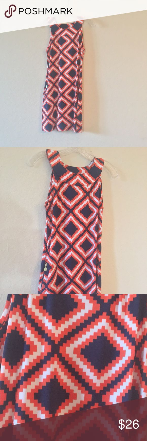 Tracy Negoshian orange and blue dress Stand out in this beautiful Tracy Negoshian diamond print dress! Great addition to any UF fan's closet!   Tracy Negoshian dress. Orange & navy diamond print. Sleeveless zip up body con. 95% polyester  5% Elastane Tracy Negoshian Dresses