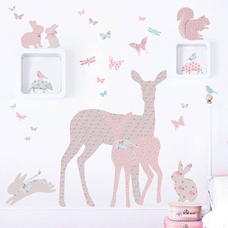 These woodland animal wall stickers make an enchanting addition to girls' rooms and nurseries.The silhouettes of the animals are made with a range of floral, gingham check and polkadot fabric patterns in shades of vintage pink and aqua. Use them to create a feature wall or scatter them around different areas of a room. The set contains:A deer and fawn • 4 rabbits • 2 squirrels • 2 hedgehogs • 5 birds • 50 butterflies As with all of our wall stickers they are made fro...