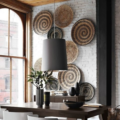 Decorative bowl art and brick wall. {So pretty.} Bowls from West Elm.