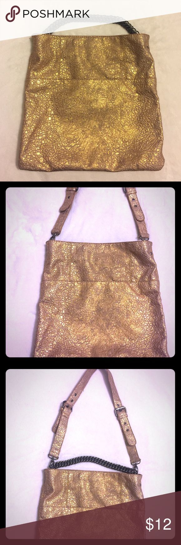 """Gold textured vegan leather tote hobo 32"""" Detachable Adjustable shoulder strap w/ dark Metal hardware. Also has a small intricately looped metal strap see pictures for details. Magnetic Hidden closure. 13.5"""" h x 14.5"""" wide soft hobo style tote with CLEAN brown fabric interior. Has 3 interior pockets to hold your phone, lipstick including a zipper pocket to hold your wallet. Great for looking cute while sneaking snacks into the movies with you BFF OR your boyfriend lol. GAP Bags Hobos"""