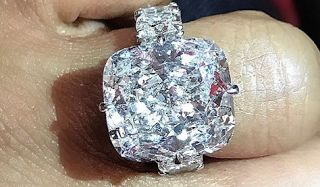 """Gucci Mane Fiancée Keyshia Dior 25 Carat Diamond Engagement Ring  Gucci Mane surprised his new fiancée Keyshia """"Dior"""" Ka'oir with a 25 carat diamond engagement ring during Tuesday night's Atlanta Hawks game. The Atlanta rapper popped the question during the Kiss Cam segment of the basketball game and we're convinced that Keyshia had no clue about what Gucci had planned.  Scroll to the video below to see Gucci propose to Keyshia! If Ka'oir would have known that Gucci was planning to propose…"""