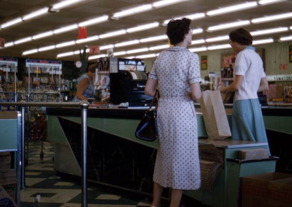 View showing customer at the checkout counter in a Publix supermarket in Sarasota, Florida, 1958.