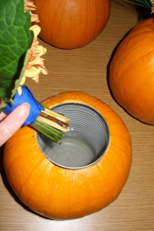 Make a hole in a pumpkin large enough for a vase type can. Then place water and flowers in the pumpkin!!