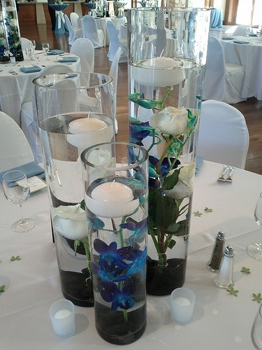 Trio of tall cylinder vases with sunken orchids and roses Designed By: hillside-consultants.com
