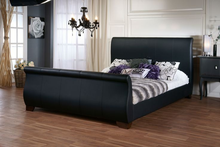 5ft Duchess Black Faux Leather Bed Frame - £419.95 - The 5ft Duchess bed frame has a high footend and is of a sleigh design in a soft and supple black faux leather.  A very impressive bed frame and certainly makes a statement.  The frame is made so that your mattress sits down inside the frame on sprung slats creating a lower profile.