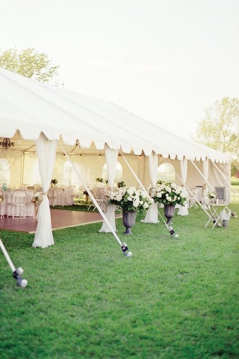 The frame tent is one of the most common types of party tent out there. Instead of poles, it uses a metal frame to support the tent and is free standing so it can be set up on most solid surfaces. While it may not be as beautiful as the pole tent, it is more versatile. Inside the tent, the metal pipes are exposed and can left as they are to hang lights and decorations, or hidden with layers of draped fabric.