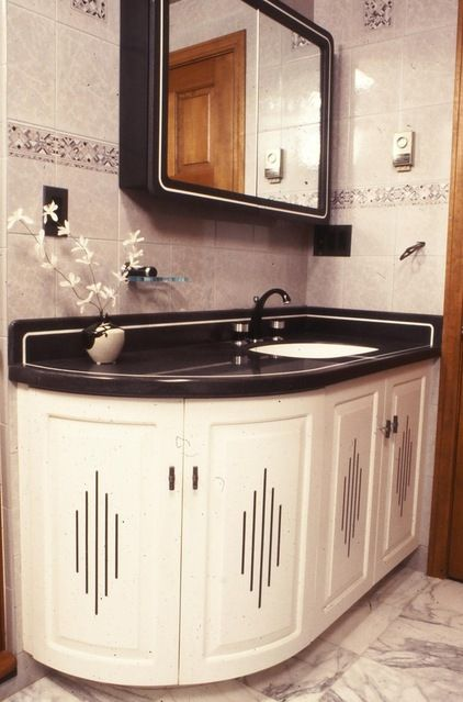 Love the rounded corner, so much more attractive and sensible. Great for the guest bath.  eclectic bathroom by A Woodworkers Studio