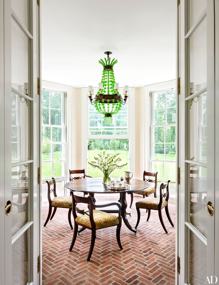 2036 best dinning rooms images on pinterest architecture a green beaded chandelier hangs above an antique english table on the enclosed porch mozeypictures Image collections