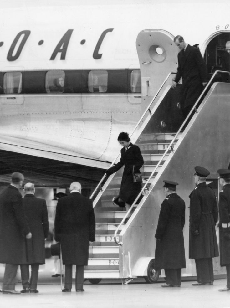 Queen Elizabeth II and Prince Philip arriving back in England to mourn the death of her father, King George VI, in February 1952. Image Source: Getty / Popperfoto  -  April 2, 2017