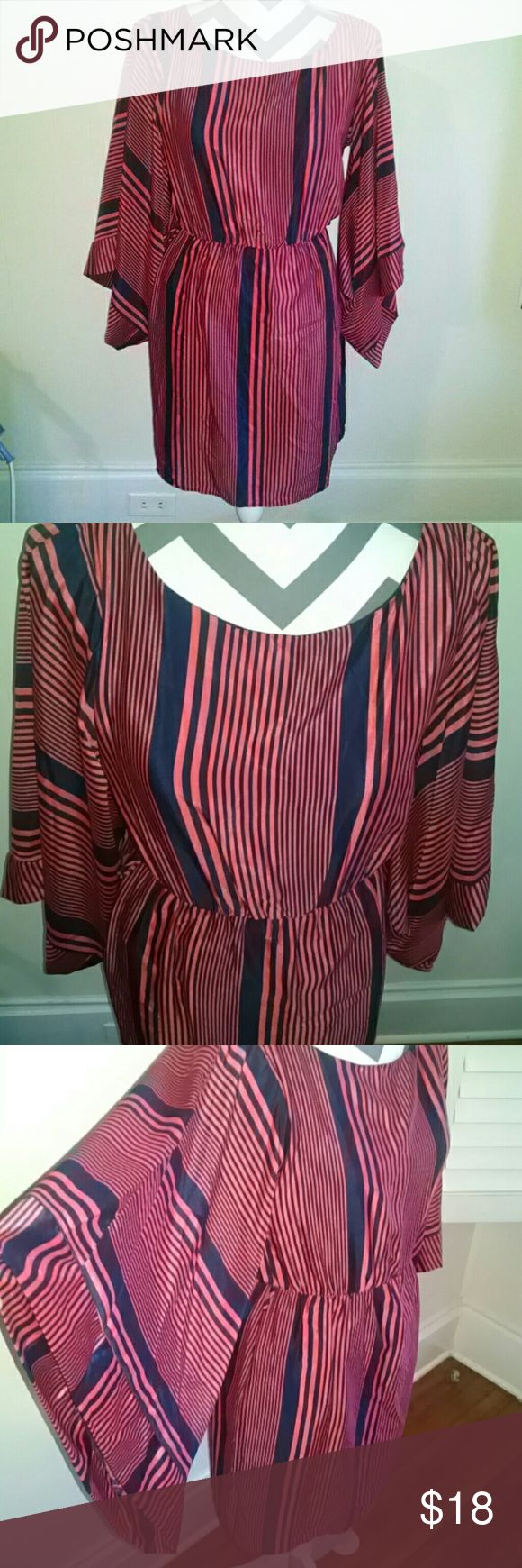 NWT Pink Owl Batwing Open back Dress This dress is the coolest! The batwing type sleeves & open oval back really make this dress special. Beautiful blue navy & orange stripe pattern. Belt loops on each side if you wanted to add a belt. Has blue lining. Unfortunately it doesn't fit me otherwise I'd definitely keep it! New with tags! pink owl  Dresses