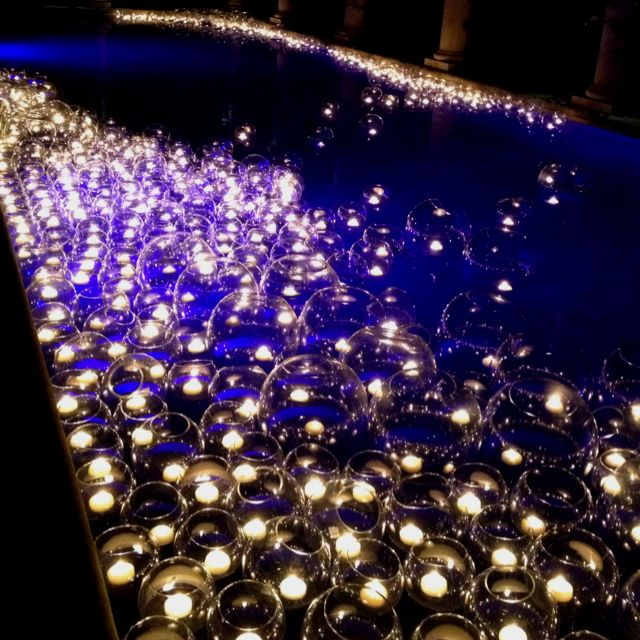 floating candles. Pool or pond. Cute idea for summer evening gatherings at the house.