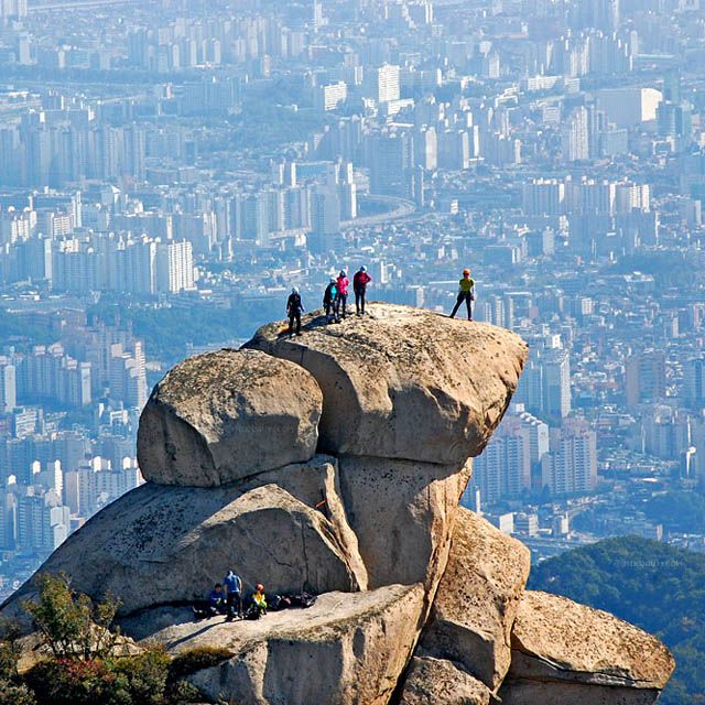 """Bukhansan or Bukhan Mountain, is a mountain on the northern peripheries of Seoul, South Korea. At 836.5 meters above sea level and bordering a considerable part of the city, Bukhansan is a major landmark visible from most districts of the metropolis. The name """"Bukhansan"""" means """"Mountain north of the Han,"""" referring to its location approximately ten kilometers to the north of the Han River."""