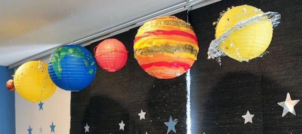 A cute Solar System Backdrop from this Astronaut Themed 2nd Birthday Party via Kara's Party Ideas | KarasPartyIdeas.com #solarsystembackdrop #spaceparty #planets