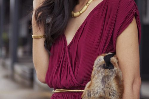 Tiny tiny pleats. maroon and gold. and faux (?) fur. very seventies chic.