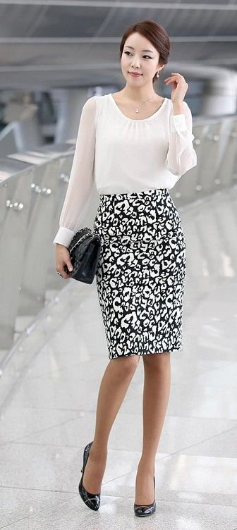 Printed pencil skirt and sheer blouse. Pair with basics to keep it work-appropriate.