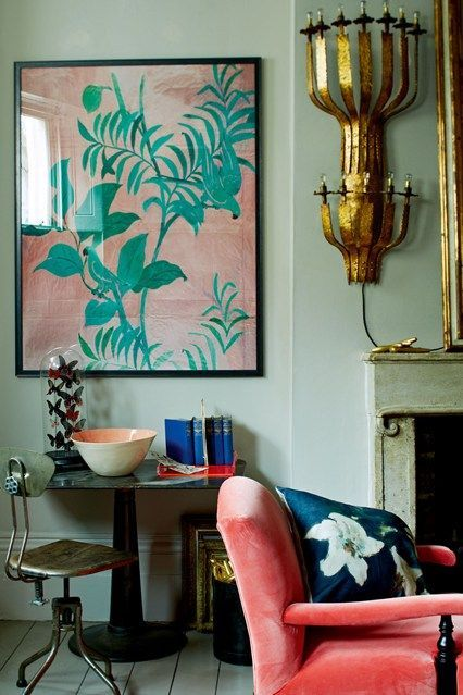 Kristin Perers - coral English armchair, unique brass sconce, mint walls, glass dome with butterflies