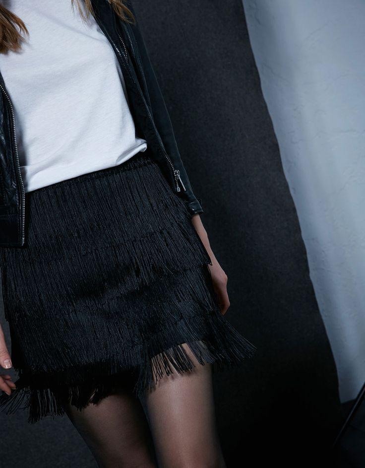 Fringed mini skirt.