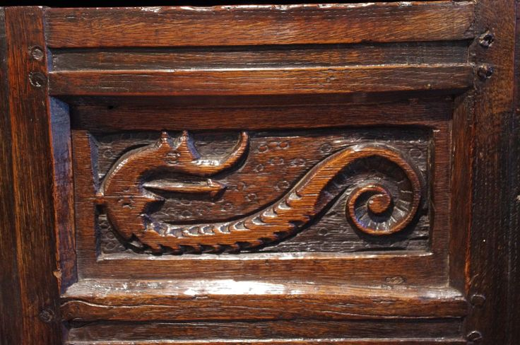 Late 17th century Welsh oak deudarn with carved dragon decoration.