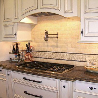 Antique white kitchen cabinets granite countertop dark for Antique white kitchen cabinets with black granite countertops